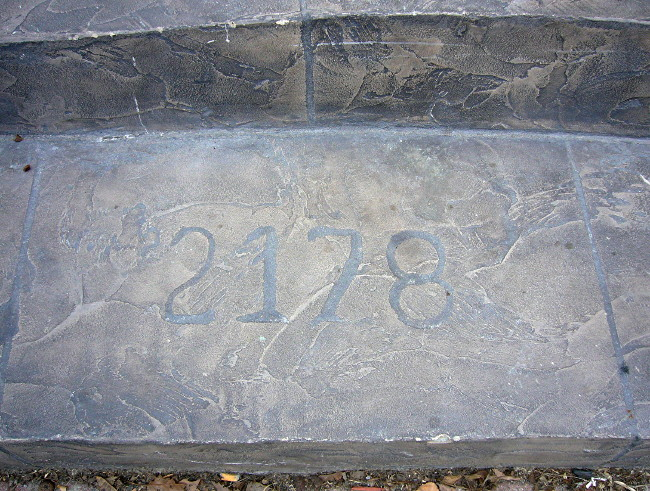 Flagstone step is inscribed with 2178