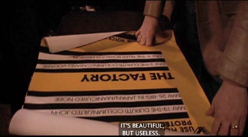 (Views yellow poster with black type set on black and white lines.) WILSON: It's beautiful, but useless.