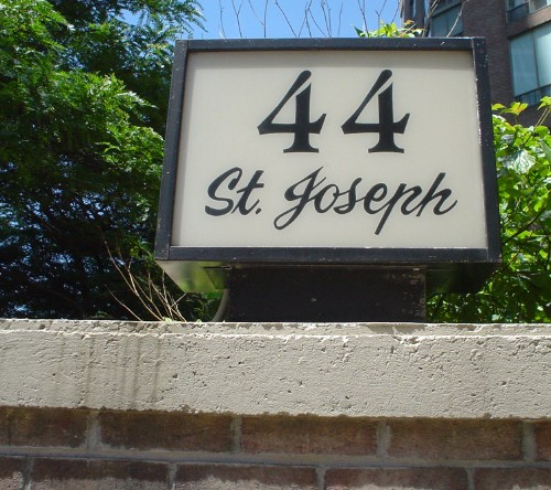 Lightbox sign on cement wall reads 44 St. Joseph, with 'St. Joseph' in hand-drawn script