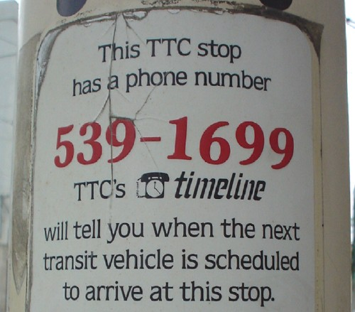 Decal reads 'This TTC stop has a phone number. 539-1699. TTC's TimeLine will tell you when the next transit vehicle is scheduled to arrive at this stop'