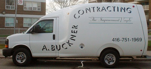 Modern cube van with ærodynamic edges is labelled A. BUCKNER CONTRACTING The Improvement People in drop-shadow and cursive fonts