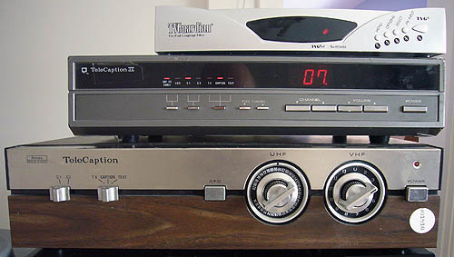 Small silver set-top box, large silver one, huge woodgrain box with rotary dials