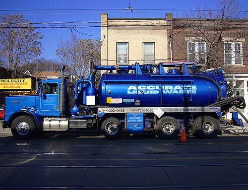 Electric-blue tanker truck is labelled ACCURATE LIQUID WASTE