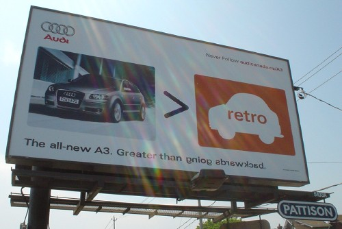 Audi billboard has slogan 'The all-new A3. Greater than going backward' with the last two words flipped to read backwards