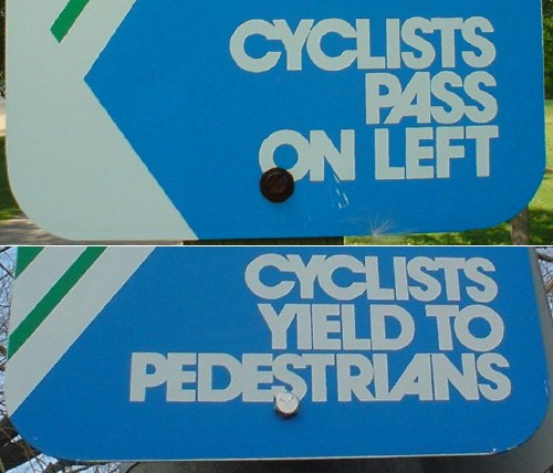 Avant Garde Gothic capital letters read 'Cyclists Yield to Pedestrians' and 'Cyclists Pass on Left,' with ligatures for some combinations