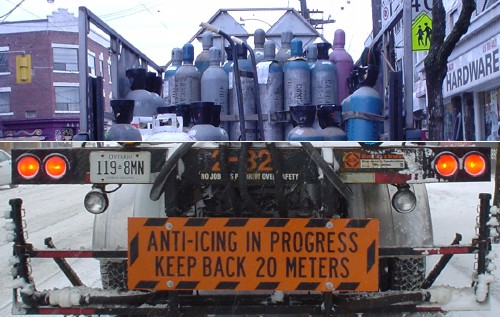Split image of two trucks shows a payload of free-standing compressed-gas cylinders on top and a sign reading 'Anti-Icing in Progress. Keep Back 20 Meters' below'