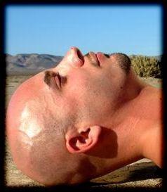 Latino baldy on cracked desert earth