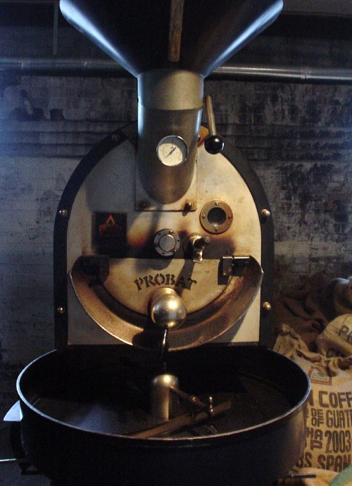 Giant stand-up coffee-mixing machine with large hopper and auger
