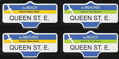 Four signs reading QUEEN ST. E. with blue band at top