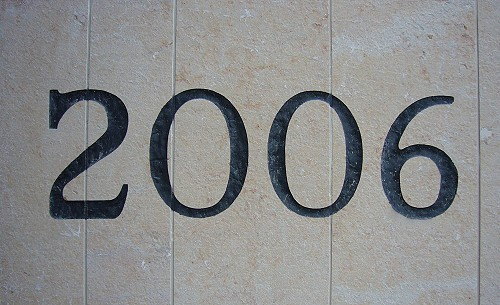 Inscription in stone wall reads 2006, with overlarge serif on 2, wide 0, and arm of 6 that extends slightly to the right