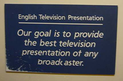 Sign reads English Television Presentation: Our goal is to provide the best television presentation of any broadcaster