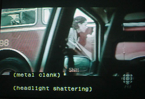 Subtitle reads Shit! as captions, separated by a blank line, read (metal clank) and (headlight shattering)
