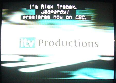 Centred caption reads I'm Alex Trebek. Jeopardy! premieres now on CBC.