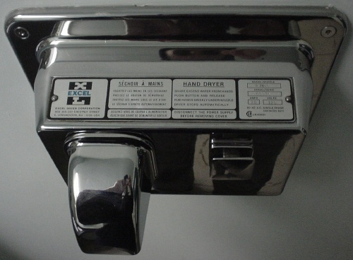 Chrome hand dryer with instructions set in template lettering