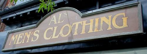 Vintage-like sign reads AL'S MEN'S CLOTHING