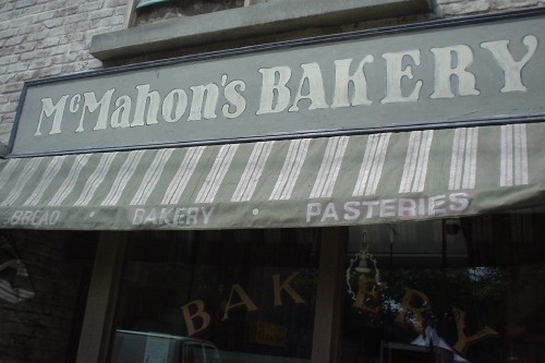 Vintage-like sign reads McMAHON's BAKERY