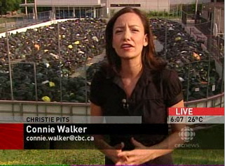 Connie Walker (Chyroned as such) standing outside temporary garbage dump
