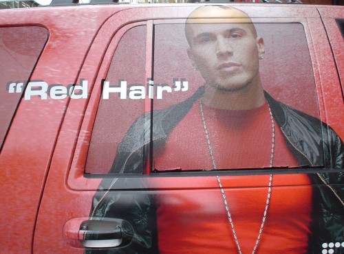 "Wrapped advertising on an SUV shows Shawn Desman and the words ""Red Hair"""