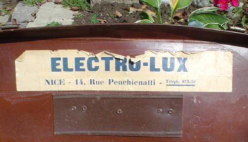 Peeling label on a brown lid reads ELECTRO-LUX NICE – 14, Rue Penchienatti Téléph. 873-58