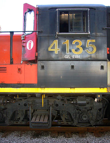 Oily-looking CN locomotive carries the number 4135 in Helvetica