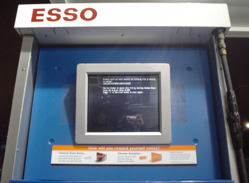 Esso gas-station display shows DOS-mode Windows error message