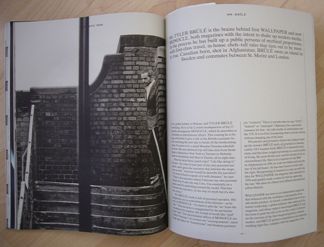 Double-page spread shows black-and-white photo of Tyler Brûlé emerging onto an outdoor staircase and a page of Times Roman text