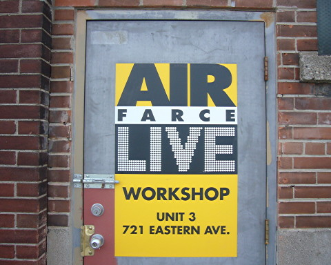 Sign on door reads AIR FARCE LIVE WORKSHOP UNIT 3 721 EASTERN AVE.