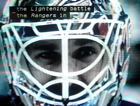 Caption includes the italicized word Lightening over an image of a goalie