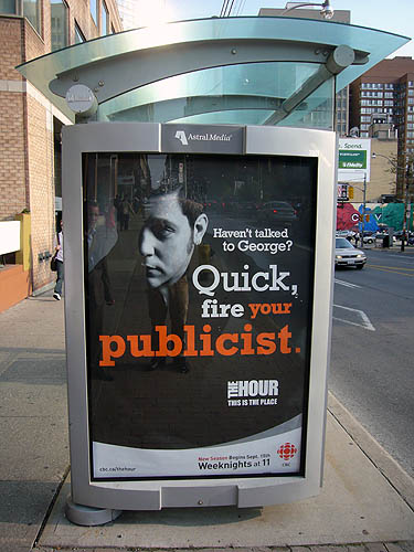 Billboard on bus shelter shows Strombo and reads Haven't talked to George? Quick, fire your publicist.