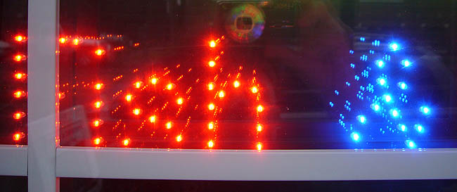 LED dots in window read Fish &