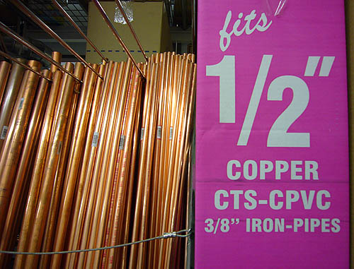 """Pink area alongside standing copper pipe reads fits ½ʺ COPPER CTS-CPVC 3/8"""" IRON-PIPES"""