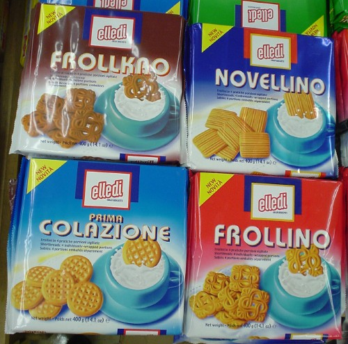 Bright square biscuit packages read FROLLKRO, NOVELLINO, PRIMA COLLAZIONE, FROLLINO in Bauhaus type