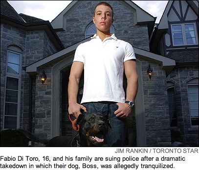 Vaguely muscular teenager in polo shirt with Rottweiler, both standing before a stone monster home