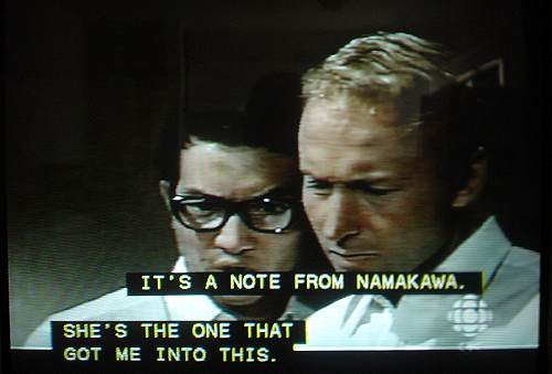 Japanese and Caucasian actors captioned in two onscreen blocks