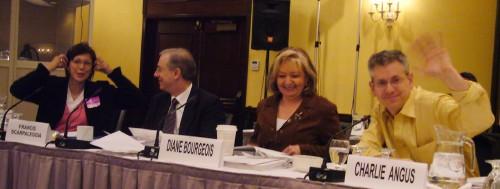 Tina Keeper, Frnacis Scarpaleggia, Diane Bourgeois, and Charlie Angus, raising his hand