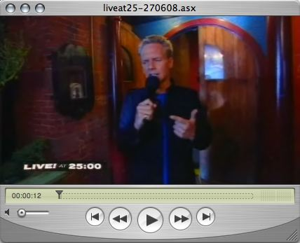 QuickTime window showing Jonathan Torrens hosting a show
