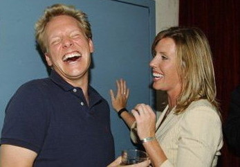 Jonathan Torrens laughing uproariously alongside semifamous blonde