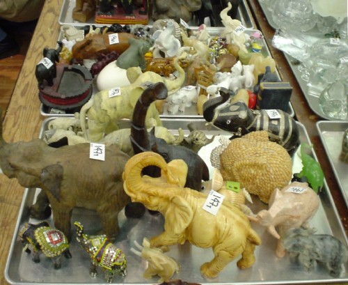 Steel trays hold dozens of elephant figurines