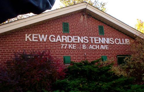 Letters on brick A-frame building read KEW GARDENS TENNIS CLUB 777 KEBACH AVE