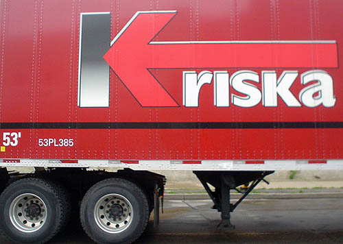Red truck is emblazoned Kriska in unicase Gill Sans (with an arrow forming the right side of the K)