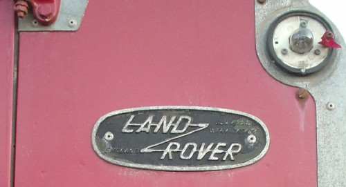 Black-and-silver badge reads LAND ROVER in Silver, with a Z-like line through the two words