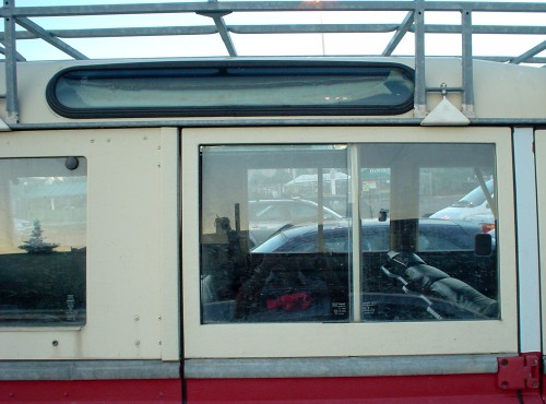 Side window, roof rack, and elliptical porthole window in roof of Land Rover