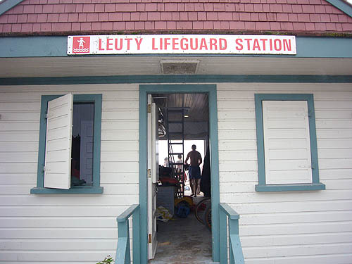 View through open front and rear doors of LEUTY LIFEGUARD STATION shows a couple of people, one wearing only shorts