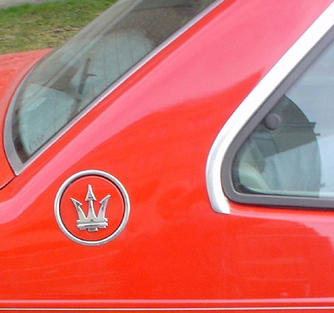 Maserati crest on red Biturbo