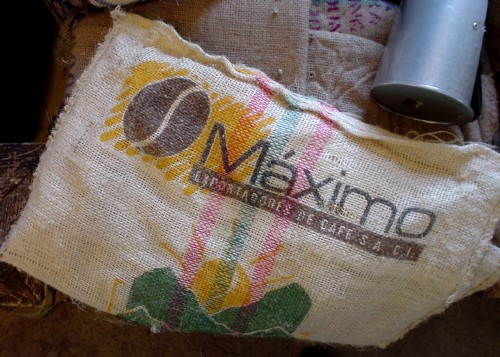 White canvas coffee bag is labeled Máximo in the Eurostyle typeface