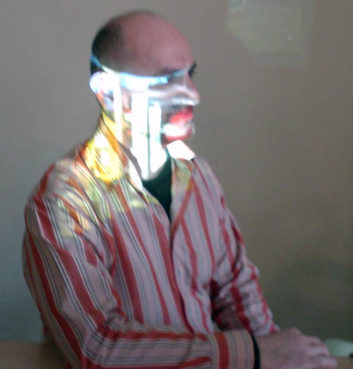 Me in red-and-white-candystriped shirt with white projected blob obscuring my profile