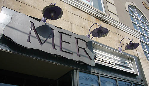 Half-broken sign reads MER in letters inscribed in slate