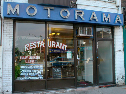 Blue sign over restaurant has widely-spaced block letters reading MOTORAMA