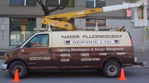 Nadir Fluorescent van, in cream and black, with rooftop cherrypicker extended. 'Moncton · London · Ottawa · Toronto · Niagara · Northern Ontario'