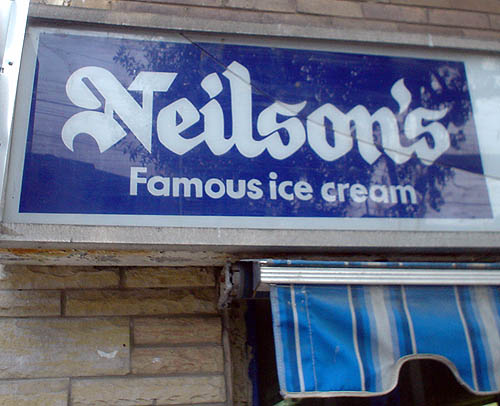 Sign reads Neilson's in blackletter type and Famous ice cream in Futura
